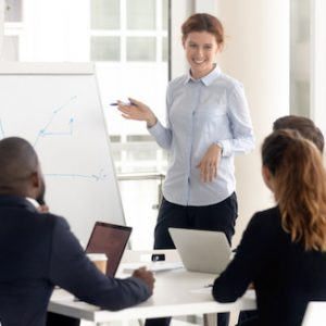 woman in meeting at whiteboard